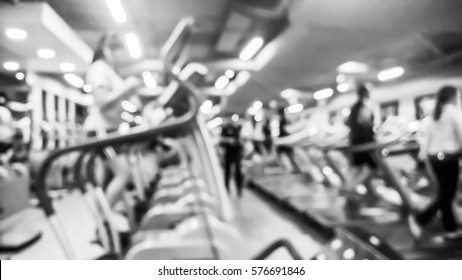 Blurred of fitness gym and people running on running machine for Healthcare concept background - Black and White
