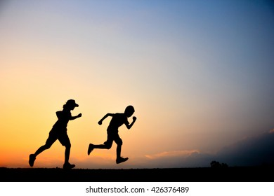 Blurred of Fitness silhouette sunrise jogging workout wellness concept.