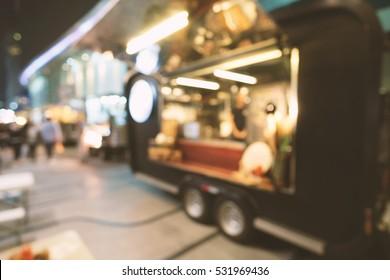 Blurred of food trucks parking.