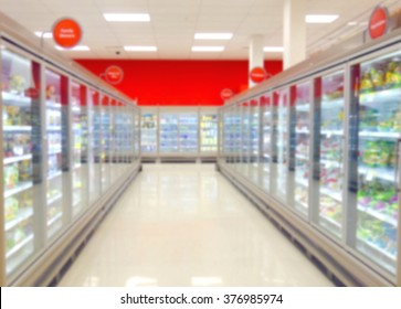 Blurred frozen food aisle at a supermarket