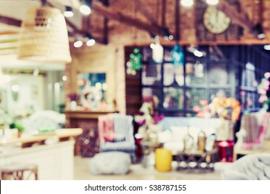Blurred furniture store interiors in a modern shopping mall. Big sale Black Friday for Christmas. Basic background for design