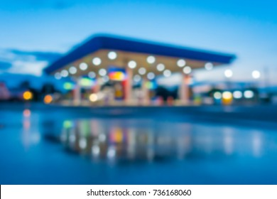 Blurred gas station background.