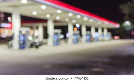 Blurred of gas station at night. Defocused, out of focus gas station and convenience store in evening. Abstract blur petrol station background with copy space. Panorama style.