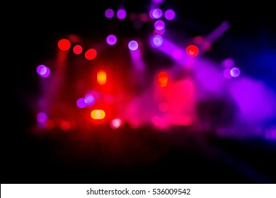 Blurred geometrical magenta and red concert lights (super high resolution) on bright stage lights with Laser rays blur