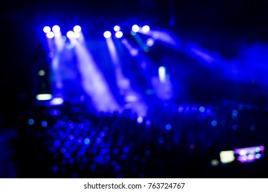 Blurred geometrical purple and white concert lights (super high resolution) on bright stage lights with Laser rays blur