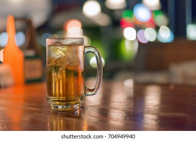 blurred glass of beer in bar background