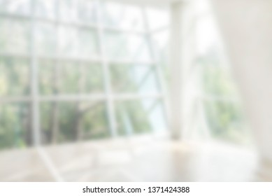 Blurred glass windows with green forest Soft focused image useful as background