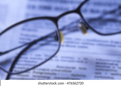 Blurred Glasses on newspaper Reading concept