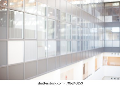 Blurred glimpse of a modern building with square windows