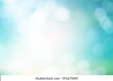 blurred glowing teal color background.
