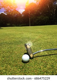 Blurred golf ball in golf course