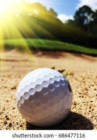 Blurred golf ball on sand in golf course