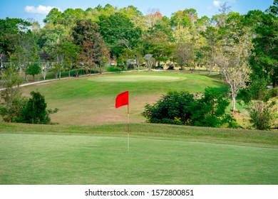Blurred golf flag in golf course on blurred layout and fairway background