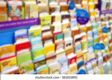 Blurred greeting cards display at a store