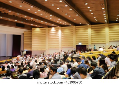 blurred group adult people meeting start up business program collaboration discussion and listen in convention hall background concept.