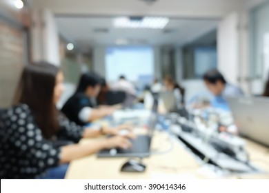 blurred group of employee thoughtful programming code system in information technology department.