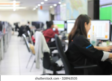 blurred group of employees working or learning about program at the computer in operation room
