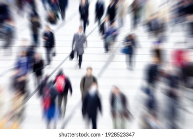 Blurred group of people walking during rush hour
