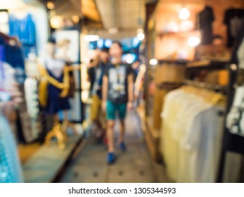 Blurred group of tourist people shopping in souvenir shop, Business people
