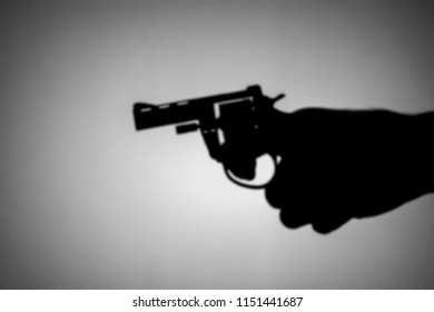 blurred of a gun in his hand.