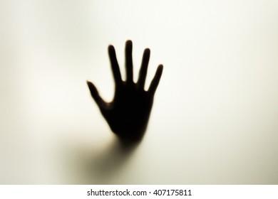 blurred hand on the mirror blur background