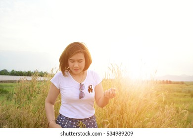 blurred of happy woman stand on filed meadow with sunlight