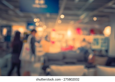 Blurred home-store shopping mall background with vintage color tone tuned