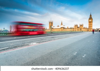 Blurred iconic bus and Big Ben in London, sunrise at Westminster Bridge