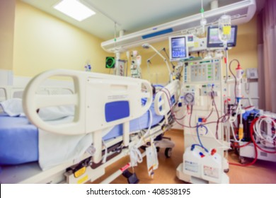 Blurred ICU room in a hospital with medical equipments and patient.