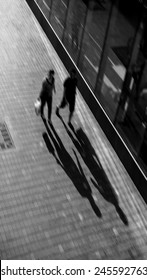 Blurred image abstract human shadow walk in the city. black and white design for background.