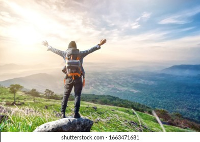 Blurred image of The adventure Concept. The background Life on the edge Traveler on cliff mountains over enjoying landscape Travel Lifestyle success motivation adventure active vacations outdoor.