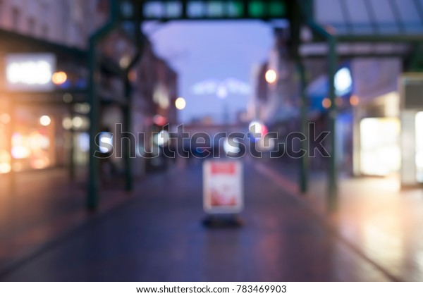 Blurred image of advertising board or advertising stand on street with night light,