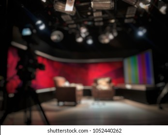 blurred image against television studio with camera