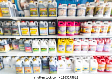 Blurred image of agriculture chemicals product shelves interior defocused background in agriculture store