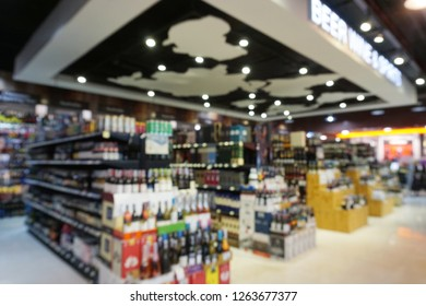 Blurred image of alcoholic beverages shelves display in a department store.