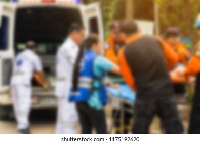 blurred image of the ambulance with the rescue team are working