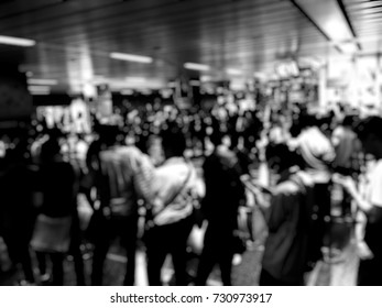 blurred image of asian people on the queue line on rush hour waiting for train subway station. Stay in the crowd cause stress in everyday life and jeopardize people health. Transport concept,