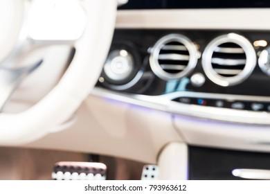 blurred image background of abstract modern luxury car interior details. Car interior luxury. blur texture, bokeh background