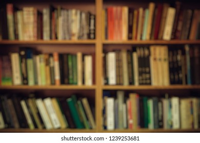 Blurred image background. Bookcase in the library