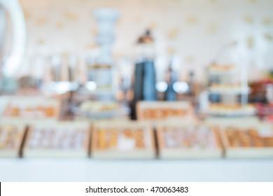 Unscharfes Bild auf buntem Hintergrund für die Konditorei-Präsentation auf gemütlichem Hintergrund