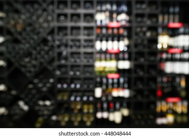 Blurred image, Background Wines in restaurant show on shelf wall.
