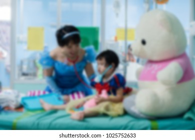 Blurred image of  beautiful doctor and pediatric patients with treatment in the hospital.