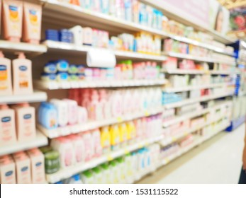 Blurred image beauty stores, Department store with bokeh blurred background, Abstract blurred supermarket shelf with colorful cosmetic goods as background.