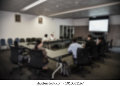 blurred image of board of Directors, education people, business team, employees, young colleagues sitting in conference room or meeting room in the office for group discussion and brainstorming.