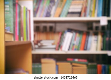 Blurred image - books on the shelves in the library