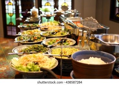 blurred image breakfast buffet table at hotel restaurant sign is show Steamed rice