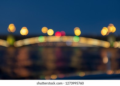 blurred image of a bridge with lights at night
