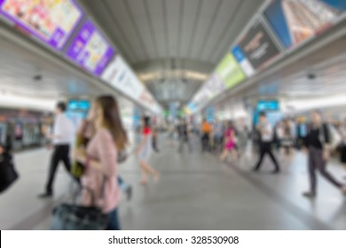 Blurred image of BTS Siam Station in Bangkok Thailand in rush hour