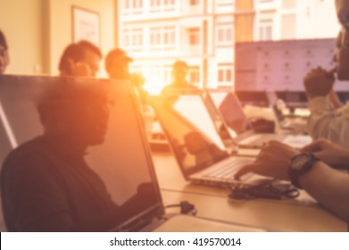 Blurred image of business people meeting at office ( Filtered image processed light effect. )