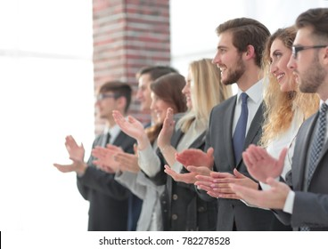 blurred image of business team applauding